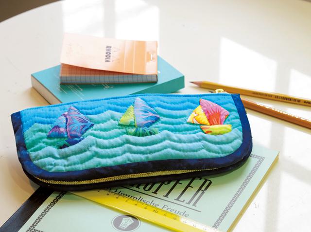 洋輔さんが作る、ハワイの海をアップリケした「2ウェイポーチ」